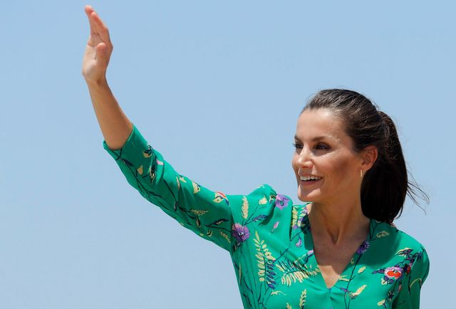 palma de mallorca, spain   june 25 queen letizia of spain waves at spectators as she takes a walk with her husband king felipe of spain on promenade of platja de s'arenal on june 25, 2020 in palma de mallorca, spain this trip is part of a royal tour that will take king felipe and queen letizia through several spanish autonomous communities with the objective of supporting economic, social and cultural activity after the coronavirus outbreak photo by clara margaisgetty images