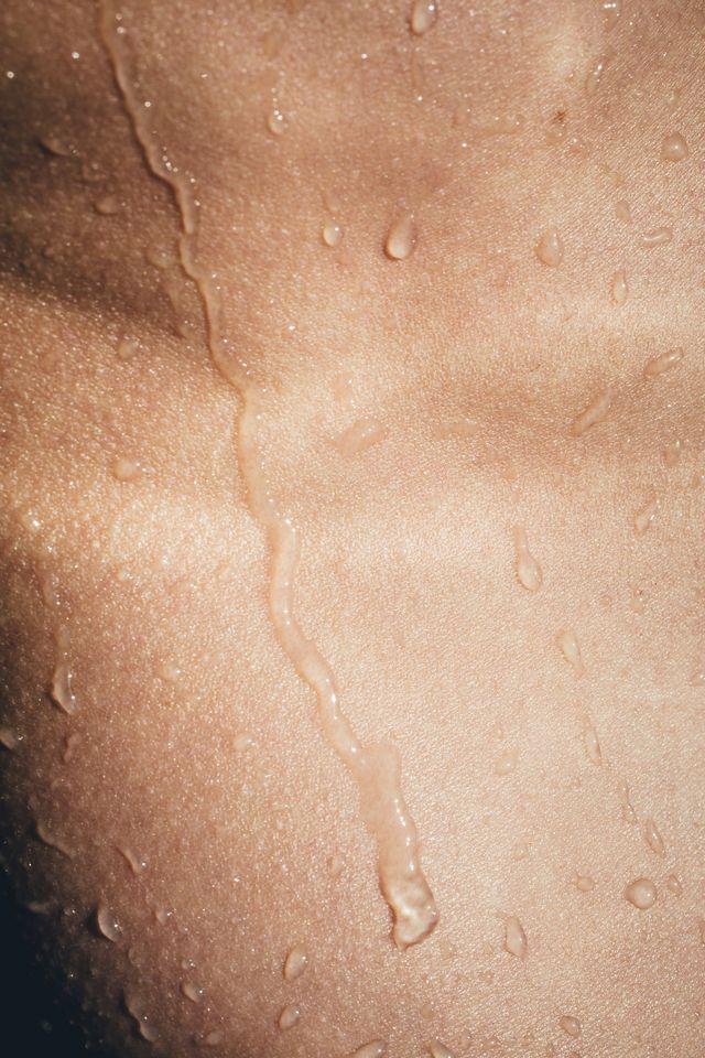 sensual image of wet skin closeup, wet body, tan skin