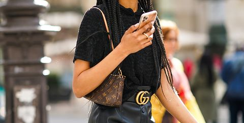 paris, france   july 03 a passerby wears a black t shirt, a brown leather monogram vuitton bag, a gucci belt, a black leather skirt, on july 03, 2020 in paris, france photo by edward berthelotgetty images