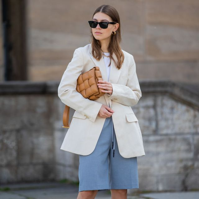 berlin, germany   july 07 swantje soemmer is seen wearing arket blazer, blanche shorts, bottega veneta bag, mailaika rais necklace, mules numeroventuno no21, rayban sunglasses on july 07, 2020 in berlin, germany photo by christian vieriggetty images