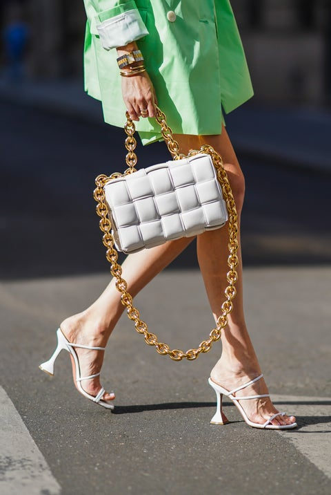 paris, france   july 12 leonie hanne wears a pale green oversized long blazer jacket from bernadette, pale green short pants from bernadette, a bottega veneta white paddedquilted woven leather bag with a golden chain, heels shoes from amina muaddi, on july 12, 2020 in paris, france photo by edward berthelotgetty images