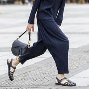 berlin, germany   july 22 trend scout julian daynov, wearing dark blue plisse pants and a dark blue plisse top by issey miyake, a white mini bag by jil sander, white sneakers by common projects, a dark blue cap by prada and sunglasses by celine during a street style shooting on july 22, 2020 in berlin, germany photo by streetstyleographgetty images