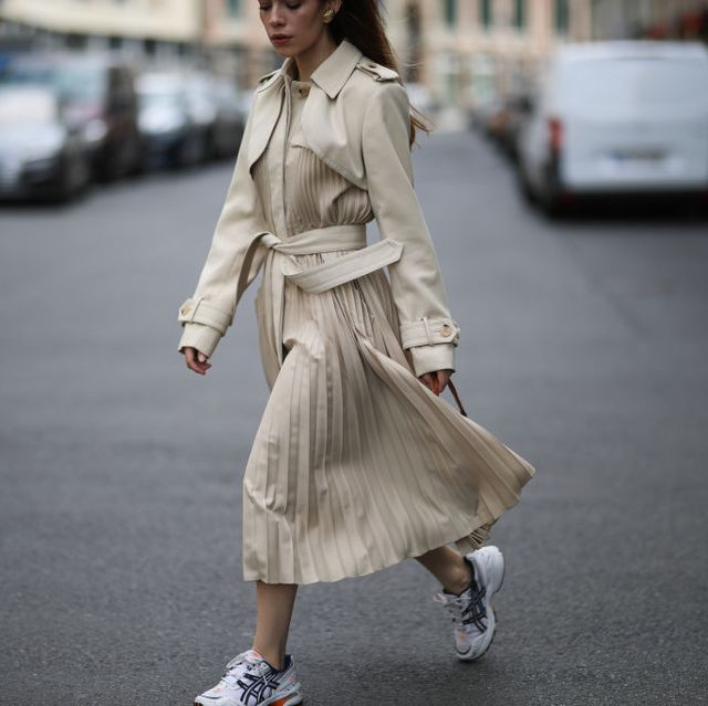 berlin, germany   july 27 frankie miles wearing sandro trenchcoat, dad sneakers asics gel 1090 and mini pouch louis vuitton on july 27, 2020 in berlin, germany photo by jeremy moellergetty images