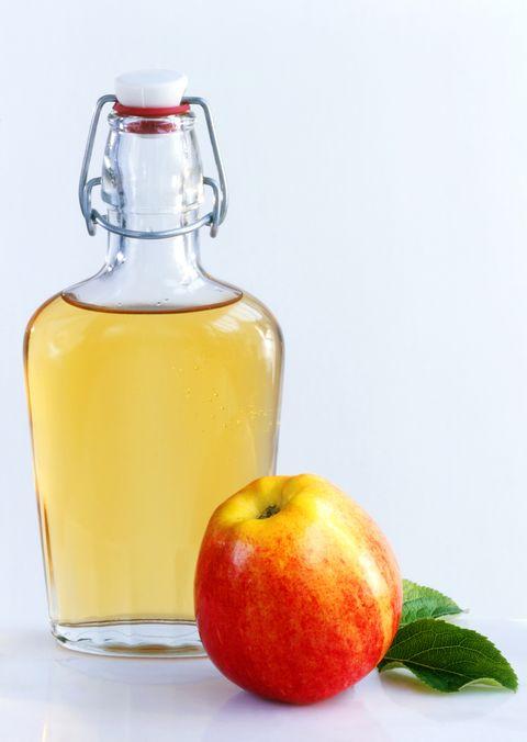 Apple cider vinegar, Glass bottle, Apple, Drink, Fruit, Liqueur, Apple juice, Food, Bottle, Juice,
