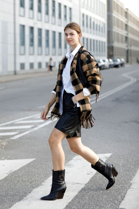 copenhagen, denmark august 11 influencer jacqueline zelwis, wearing a yellow black checked jacket with fringes by sandro, a white blouse by gestuz, black cowboy boots by fendi, a black shorts by meotine and chains by black palms the label during a street style shooting at copenhagen fashion week springsummer 2021 on august 11, 2020 in copenhagen, denmark photo by streetstyleshootersgetty images