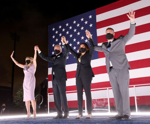 wilmington, delaware   august 20 democratic presidential nominee joe biden, his wife dr jill biden, democratic vice presidential nominee kamala harris and her husband douglas emhoff raise their arms on stage outside the chase center after biden delivered his acceptance speech on the fourth night of the democratic national convention from the chase center on august 20, 2020 in wilmington, delaware the convention, which was once expected to draw 50,000 people to milwaukee, wisconsin, is now taking place virtually due to the coronavirus pandemic photo by win mcnameegetty images