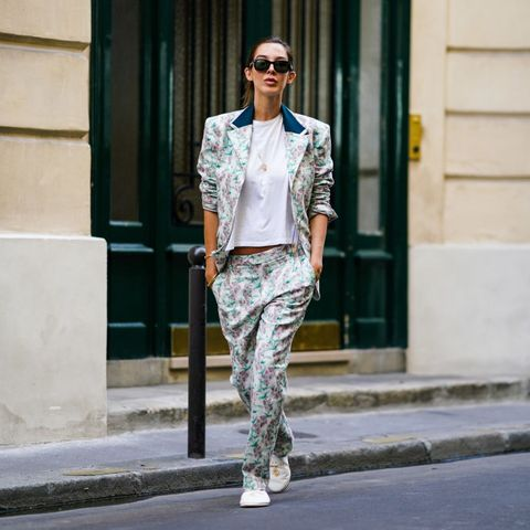 paris, france   august 26 estelle chemouny wears pastel green  pink floral print suit from charles jeffrey for paradise garage store, a golden necklace, a white t shirt, white flat shoes with golden logo from malibu hotel, ray ban sunglasses, on august 26, 2020 in paris, france photo by edward berthelotgetty images