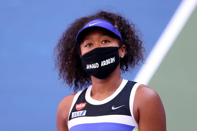 new york, new york   september 04 naomi osaka of japan wears a protective face mask with the name, ahmaud arbery stenciled on it after winning her womens singles third round match against marta kostyuk of the ukraine on day five of the 2020 us open at usta billie jean king national tennis center on september 04, 2020 in the queens borough of new york city ahmaud arbery, an unarmed 25 year old african american man, was pursued and fatally shot while jogging in glynn county, georgia photo by al bellogetty images