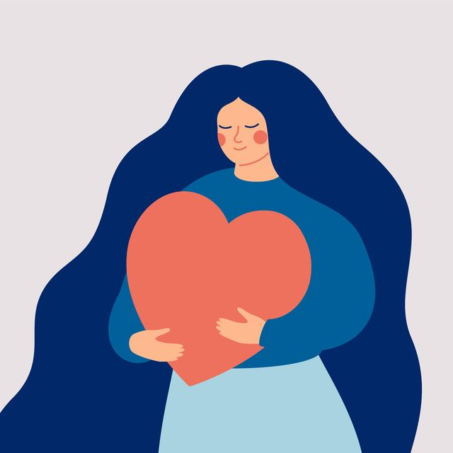 young woman embraces a big red heart with mindfulness and love self acceptance and confidence concept