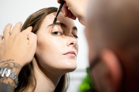 milan, italy   september 27 a make up artist does the final touch  of gel eyebrow during the line up before the show is seen backstage at the shirt fashion show during the milan womens fashion week on september 27, 2020 in milan, italy photo by rosdiana ciaravologetty images