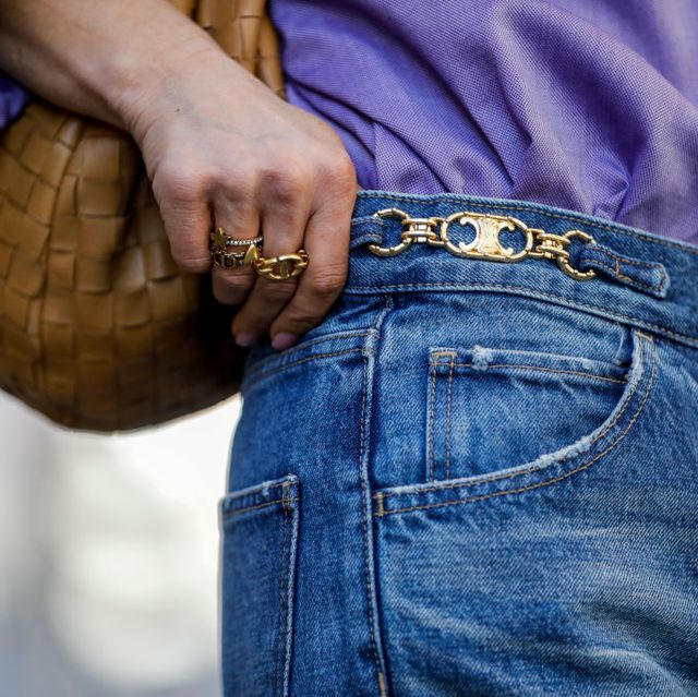 milan, italy   september 27 a dylan flared jeans with signature by celine, a cognac colored jodie bag by botteega veneta and rings by dior as a detail of influencer gitta banko, is seen during the milan women's fashion week on september 27, 2020 in milan, italy photo by streetstyleshootersgetty images