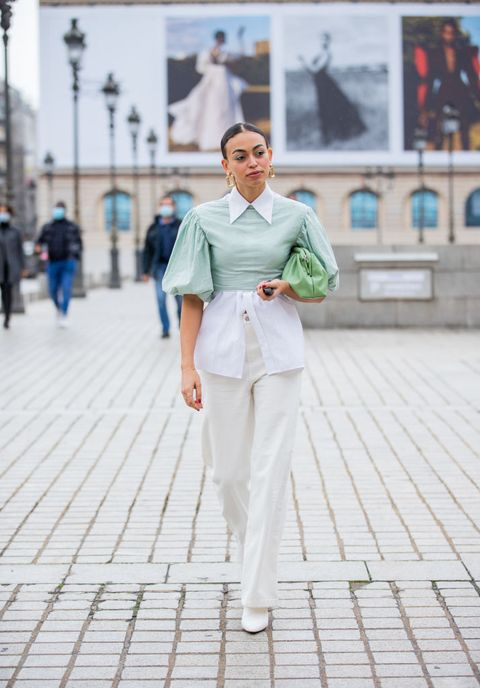 paris, france   september 29 a guest is seen wearing blouse, white button shirt, green bag outside victoriatomas during paris fashion week   womenswear spring summer 2021  day two on september 29, 2020 in paris, france photo by christian vieriggetty images