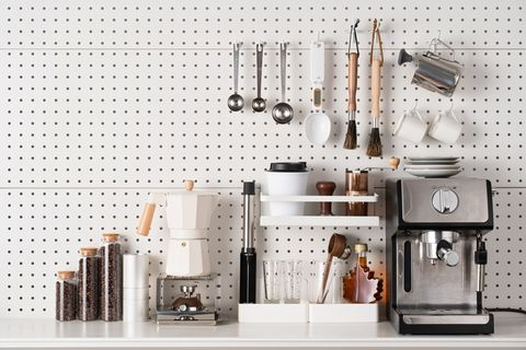 espresso coffee maker and accessories knolling on white colored pegboard background