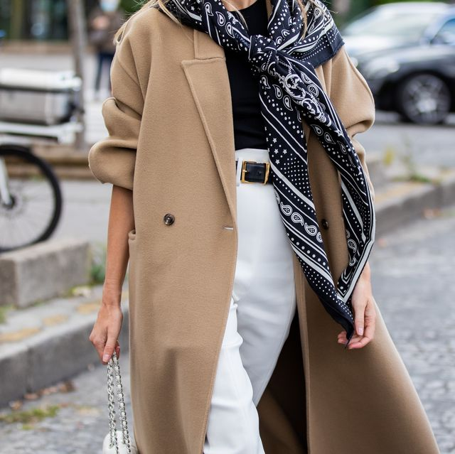 paris, france   october 03 camille charriere wearing scarf, beige wool coat, white pants outside hermes during paris fashion week   womenswear spring summer 2021  day six on october 03, 2020 in paris, france photo by christian vieriggetty images