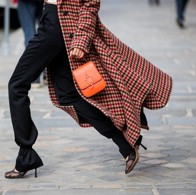 paris, france   october 08 leonie hanne is seen wearing jw anderson checkered red coat, red jw anderson bag, white dion lee top, black  jw anderson pants, bottega veneta heels during a street style fashion photo session on october 08, 2020 in paris, france photo by christian vieriggetty images