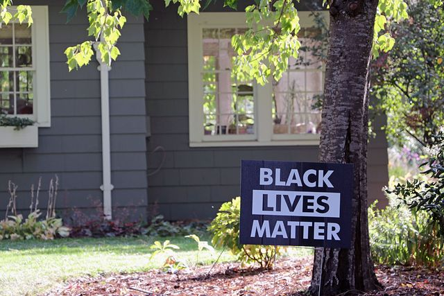 black lives matter yard sign in residential neighborhood
