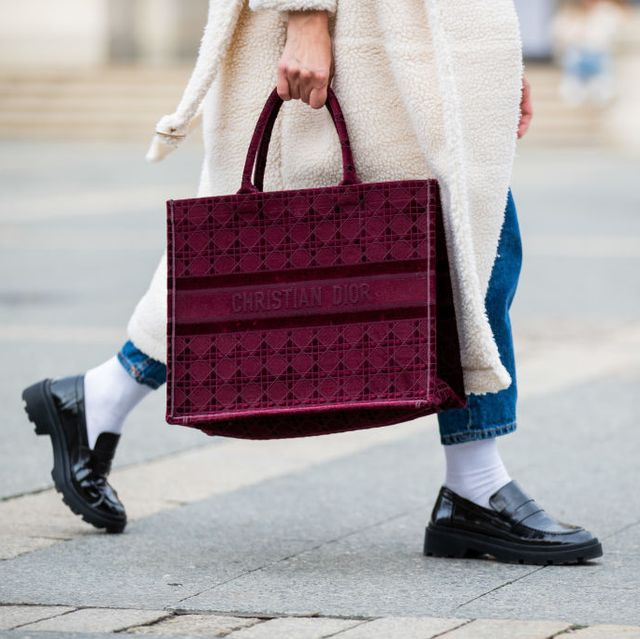 frankfurt am main, germany   october 26 victoria scheu is seen wearing creme white shearling coat sundaybay, high waist jeans levis, chunky loafers with white socks zara, red shopper tottem bag dior on october 26, 2020 in frankfurt am main, germany photo by christian vieriggetty images