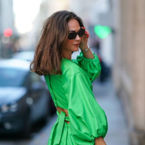 paris, france   november 05 therese hellström wears a green leather dress with puff sleeves from ccmindov, sunglasses from guess, on november 05, 2020 in paris, france photo by edward berthelotgetty images