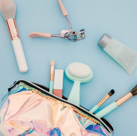 makeup bag with different types of cosmetics insid