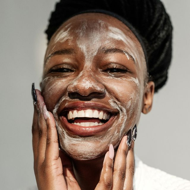 portrait of a smiling woman with a face mask