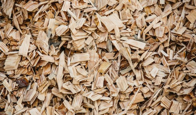 a close up view of a pile of various sized wood chipping