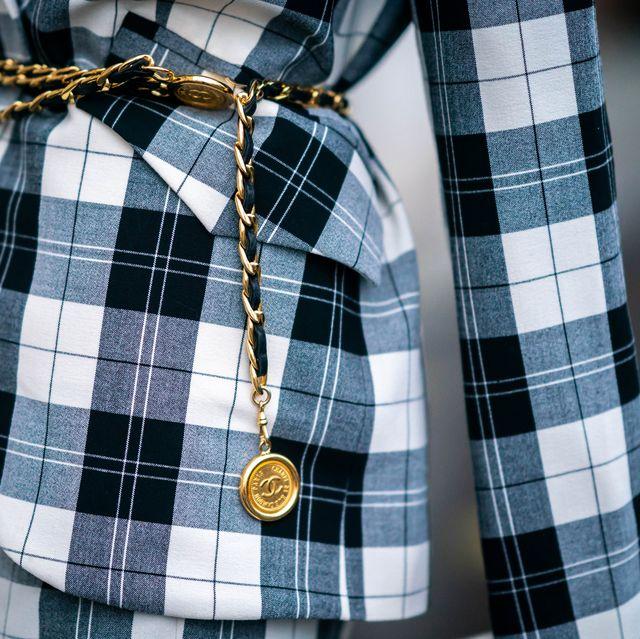 paris, france   december 04 natalia verza aka mascarada paris wears a black and white checked blazer jacket from baum pfertgarten, a golden chain belt from chanel, on december 04, 2020 in paris, france photo by edward berthelotgetty images