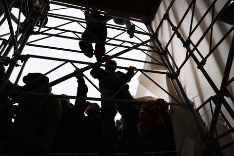 washington, dc   january 06 donald trump supporters climb a scaffolding outside the us capitol building following a stop the steal rally on january 06, 2021 in washington, dc a large group of protesters stormed the historic building, breaking windows and clashing with police trump supporters had gathered in the nations capital today to protest the ratification of president elect joe bidens electoral college victory over president trump in the 2020 election photo by spencer plattgetty images