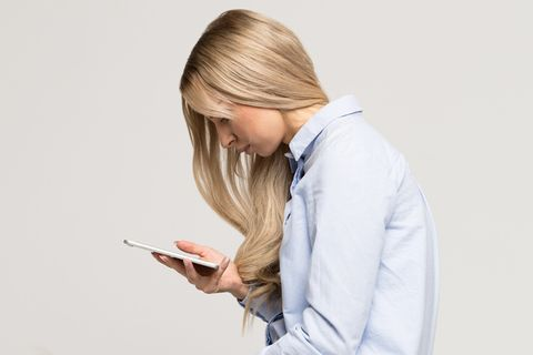 close up portrait of young woman using mobile phone with scoliosis, side view rachiocampsis, kyphosis curvature of the spine, incorrect posture, scoliosis, orthopedics concept