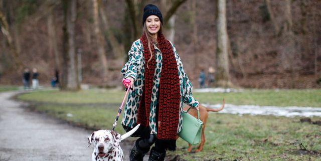 zara collectie voor honden munich, germany   january 24 influencer and tv host cathy hummels wearing a mint green bag by hermes, black faux leather pants by sassy classy, a cream colored faux fur coat with black and turquoise leopard print by msgm, a red and black scarf by missoni, a black beanie by hugo boss and black vintage boots by valentino with a dalmatian dog during a street style shooting on january 24, 2021 in munich, germany photo by streetstyleshootersgetty images