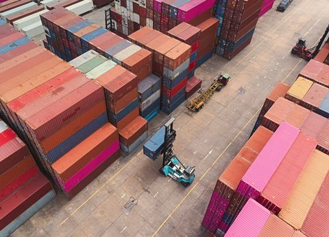 forklift handling container at terminal commercial port for business logistics, import export shipping or freight transportation