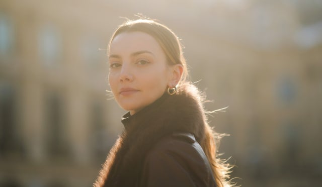 paris, france   february 10 olesya senchenko wears golden earrings, a brown leather long winter coat with fluffy collar from nour hammour, a black wool turtleneck pullover from zara, on february 10, 2021 in paris, france photo by edward berthelotgetty images