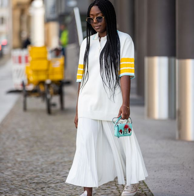 berlin, germany   february 25 lois opoku is seen wearing white polo and skirt lacoste, fendi bag, converse sneaker, boucheron sunglasses on february 25, 2021 in berlin, germany photo by christian vieriggetty images