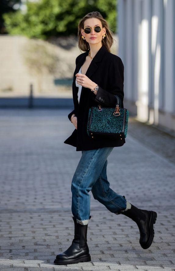 berlin, germany   march 08 mandy bork is seen wearing dior jeans, bag dior, dior watch and ring, black boots bottega veneta, black blazer topshop, linda farrow sunglasses on march 08, 2021 in berlin, germany photo by christian vieriggetty images