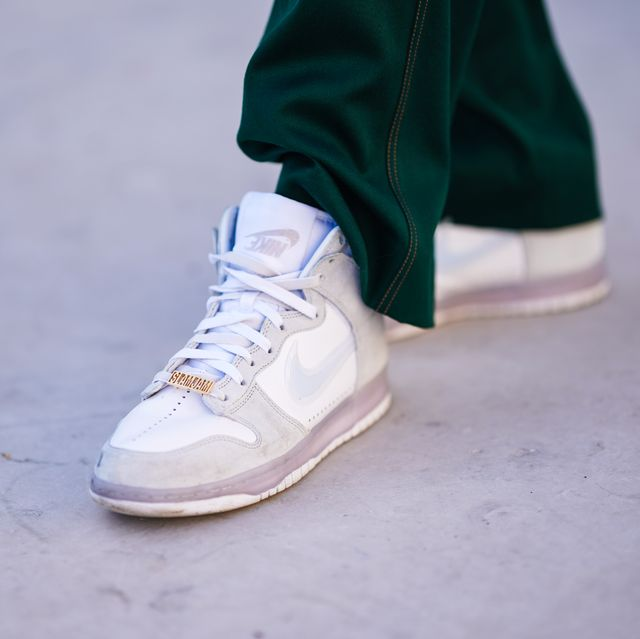paris, france   march 24 clement cornebize, fashion model, wears green jogger sport pants from sies marjan, white sneakers shoes from nike x slamjam, on march 24, 2021 in paris, france photo by edward berthelotgetty images