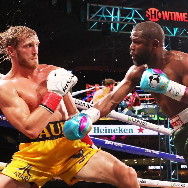 miami gardens, florida   june 06 floyd mayweather r exchanges blows with logan paul during their contracted exhibition boxing match at hard rock stadium on june 06, 2021 in miami gardens, florida photo by cliff hawkinsgetty images