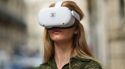 paris, france   june 04 natalia verza mascaradaparis wears a green khaki mesh jumpsuit from fendi with embroidered logo  monograms, and is playing with a vr  virtual reality oculus quest headset with a printed chanel logo, and equipped with 2 controllers, on june 04, 2021 in paris, france photo by edward berthelotgetty images