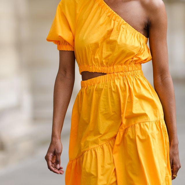 paris, france   june 05 emilie joseph infashionwetrust wears a yellow asymmetric cut out midi dress from mango, a gold ring, on june 05, 2021 in paris, france photo by edward berthelotgetty images