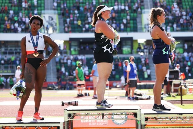 eugene, oregon   june 26 gwendolyn berry l, third place, turns away from us flag during the us national anthem as deanna price c, first place, and brooke andersen, second place, also stand on the podium after the womens hammer throw final on day nine of the 2020 us olympic track  field team trials at hayward field on june 26, 2021 in eugene, oregon in 2019, the usopc reprimanded berry after her demonstration on the podium at the lima pan american games photo by patrick smithgetty images