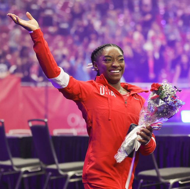 st louis, missouri   june 27 simone biles waves to the crowd as she exits following the womens competition of the 2021 us gymnastics olympic trials at america's center on june 27, 2021 in st louis, missouri photo by carmen mandatogetty images