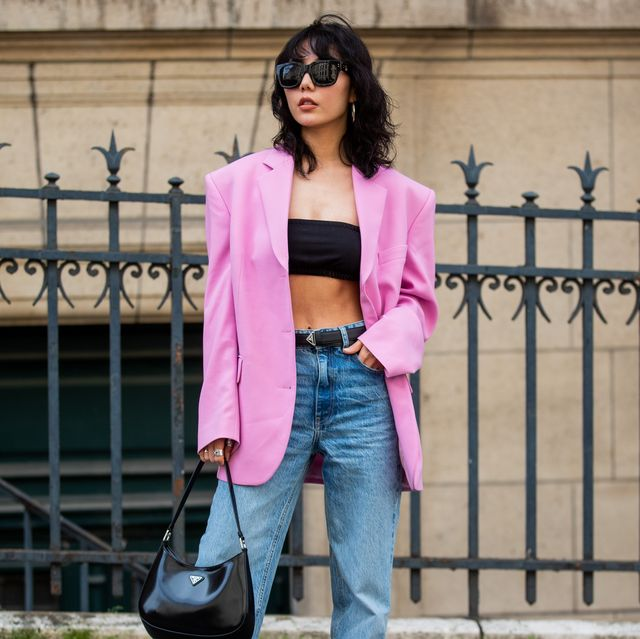 paris, france   july 07 xiayan  is seen wearing pink blazer, cropped top, prada bag, denim jeans outside zuhair murad  on july 07, 2021 in paris, france photo by christian vieriggetty images