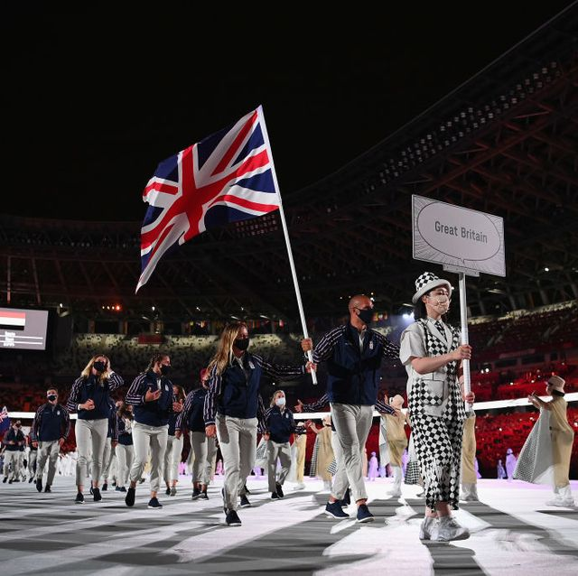 tokyo, japan   july 23 flag bearers hannah mills and mohamed sbihi of team great britain leads their team out during the opening ceremony of the tokyo 2020 olympic games at olympic stadium on july 23, 2021 in tokyo, japan photo by matthias hangstgetty images
