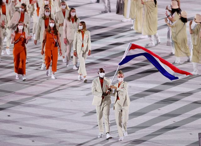 tokyo, japan   july 23 flag bearers keet oldenbeuving and churandy martina of team netherlands lead their team out during the opening ceremony of the tokyo 2020 olympic games at olympic stadium on july 23, 2021 in tokyo, japan photo by patrick smithgetty images