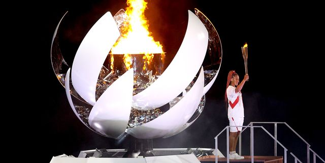 tokyo, japan   july 23 naomi osaka of team japan lights the olympic cauldron with the olympic torch during the opening ceremony of the tokyo 2020 olympic games at olympic stadium on july 23, 2021 in tokyo, japan photo by patrick smithgetty images