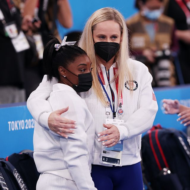 tokyo, japan   july 27 simone biles of team united states is embraced by coach cecile landi during the women's team final on day four of the tokyo 2020 olympic games at ariake gymnastics centre on july 27, 2021 in tokyo, japan photo by ezra shawgetty images