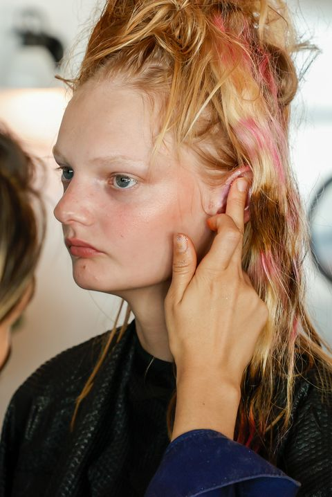 new york, new york   september 07 a model prepares backstage during the collina strada show at brooklyn grange on september 07, 2021 in new york city photo by arturo holmesgetty images