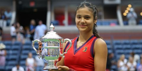 new york, new york   september 11 emma raducanu of great britain celebrates with the championship trophy after defeating leylah annie fernandez of canada during their womens singles final match on day thirteen of the 2021 us open at the usta billie jean king national tennis center on september 11, 2021 in the flushing neighborhood of the queens borough of new york city photo by al bellogetty images