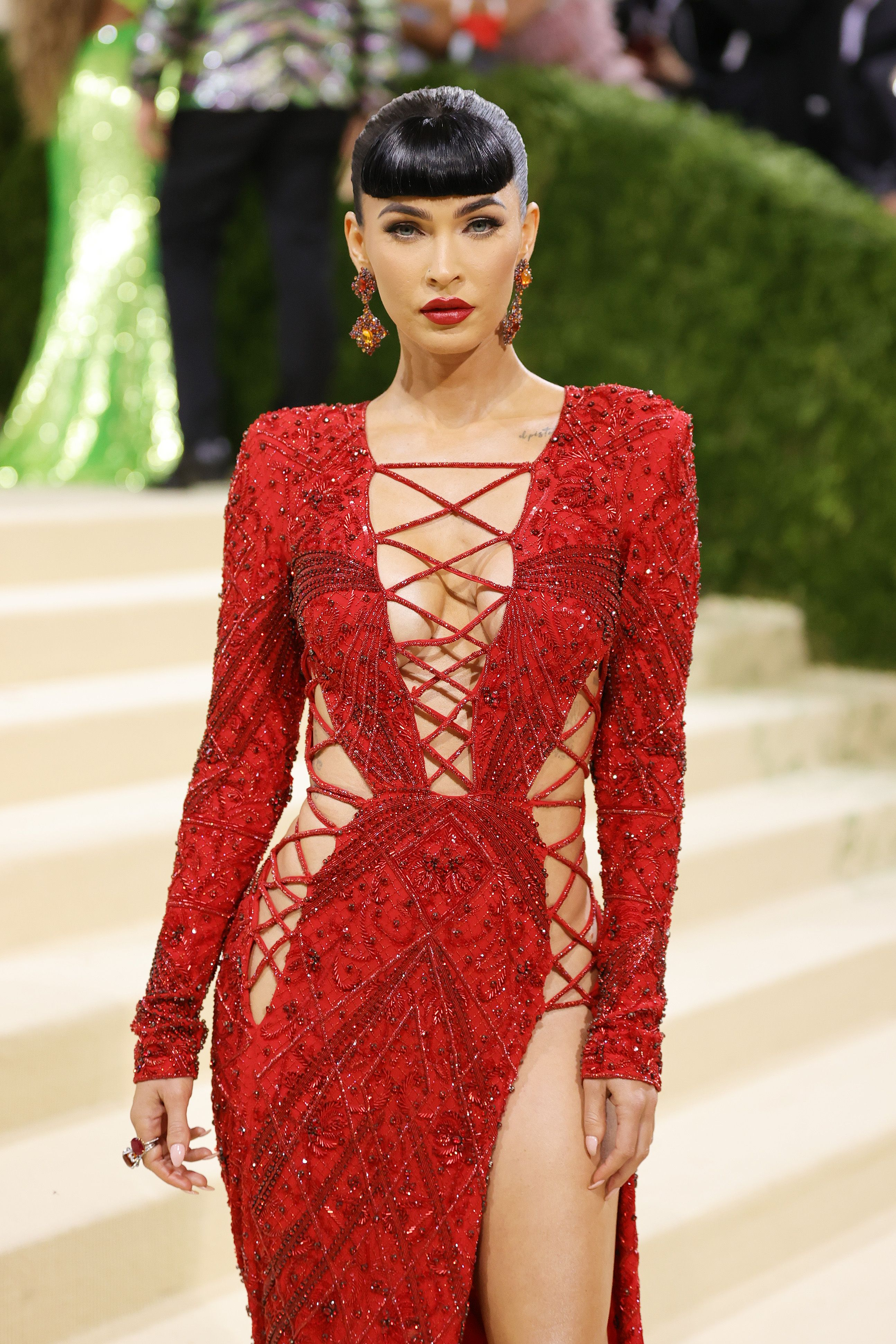 Megan Fox Sports Bangs and a Red-Hot Lace-Up Gown to the Met