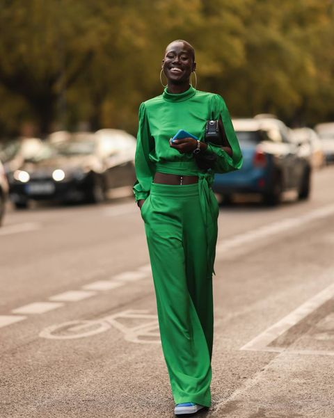 aminata sanogo wearing a green blouse and pants on september 11, 2021 in berlin, germany photo by jeremy moeller getty images