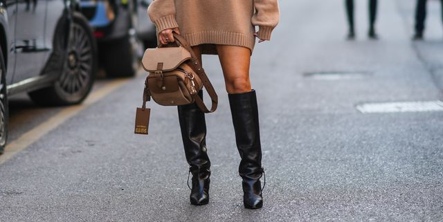 milan, italy   september 23 alexandra pereira wears black sunglasses, silver earrings, a black with white print pattern scarf, a beige wool oversized pullover dress with 1951 embroidered, black shiny leather pointed heels knees boots, a brown fabric and leather crossbody bag from max mara, outside the max mara fashion show during the milan fashion week   spring  summer 2022 on september 23, 2021 in milan, italy photo by edward berthelotgetty images
