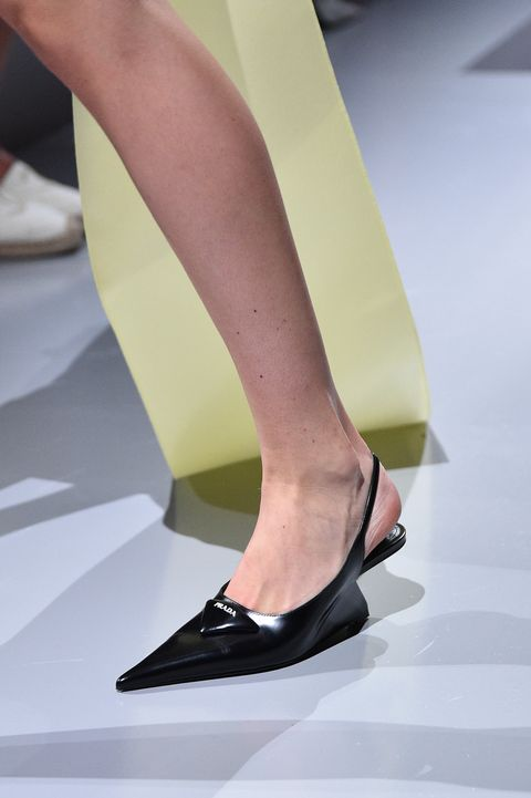milan, italy   september 24 a model, shoe detail, walks the runway at the prada womenswear spring  summer 2022 fashion show in milan during the milan fashion week   spring  summer 2022 on september 24, 2021 in milan, italy  photo by pietro dapranogetty images
